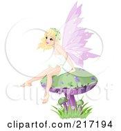 Pretty Blond Fairy Sitting On A Mushroom