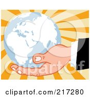 Caucasian Hand Holding A Blue Globe On A Burst Background