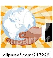 Black Hand Holding A Blue Globe On A Burst Background