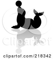 Royalty Free RF Clipart Illustration Of A Black Silhouetted Seal With Ball On His Nose And Reflection by Pams Clipart