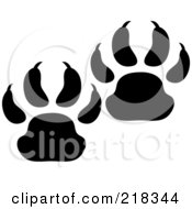 Royalty Free RF Clipart Illustration Of A Pair Of Black And White Bear Tracks by Pams Clipart