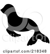 Royalty Free RF Clipart Illustration Of A Black Silhouetted Baby Seal In Profile by Pams Clipart