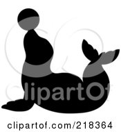 Royalty Free RF Clipart Illustration Of A Black Silhouetted Seal Balancing A Ball On His Nose by Pams Clipart