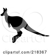 Royalty Free RF Clipart Illustration Of A Hopping Black Silhouetted Kangaroo In Profile