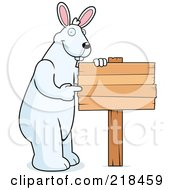 Royalty Free RF Clipart Illustration Of A Big Rabbit Standing And Pointing To A Blank Wood Sign