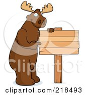 Royalty Free RF Clipart Illustration Of A Big Moose Standing Next To And Pointing At A Blank Wood Sign