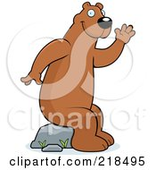 Royalty Free RF Clipart Illustration Of A Friendly Bear Sitting On A Rock And Waving