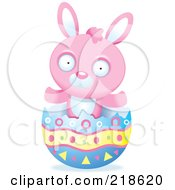 Royalty Free RF Clipart Illustration Of A Pink Rabbit In A Broken Easter Egg Shell by Cory Thoman
