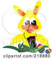 Yellow Duck Wearing Bunny Ears By Easter Eggs With A Camera