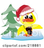 Yellow Christmas Duck With A Camera By A Christmas Tree