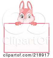 Cute Pink Rabbit Looking Over A Blank Sign