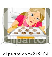 Royalty Free RF Clipart Illustration Of A Dirty Blond Woman Pulling Chocolate Chip Cookies Out Of An Oven by BNP Design Studio