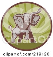 Royalty Free RF Clipart Illustration Of A Brown And Green Elephant Logo by patrimonio