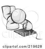 Royalty Free RF Clipart Illustration Of A White Design Mascot Laying On His Belly And Drawing On A Tablet by Leo Blanchette