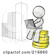 White Man Sitting On Coins And Using A Laptop By A Bar Graph