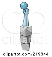 Royalty Free RF Clipart Illustration Of A Denim Blue Design Mascot Man Thinking And Standing On Blocks