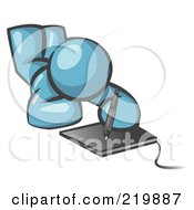 Royalty Free RF Clipart Illustration Of A Denim Blue Design Mascot Laying On His Belly And Drawing On A Tablet by Leo Blanchette