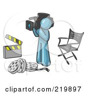 Royalty Free RF Clipart Illustration Of A Denim Blue Man Filming A Movie Scene With A Video Camera In A Studio