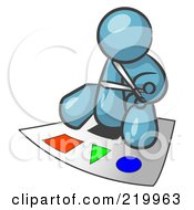 Royalty Free RF Clipart Illustration Of A Denim Blue Man Holding A Pair Of Scissors And Sitting On A Large Poster Board With Colorful Shapes