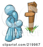 Uncertain Denim Blue Man And Child Standing At A Wooden Post Trying To Decide Which Direction To Go At A Crossroads