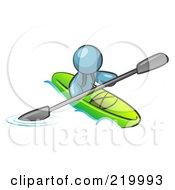 Denim Blue Man Paddling Down A River In A Green Kayak