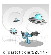 Royalty Free RF Clipart Illustration Of A Denim Blue Man Fighting Off UFOs With Weapons by Leo Blanchette