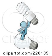 Royalty Free RF Clipart Illustration Of A Denim Blue Man Design Mascot Sitting On An Old Light Bulb And Holding Up A New Energy Efficient Bulb