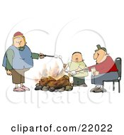 White Family With Two Parents And An Only Child A Boy Roasting Marshmallows Over A Camp Fire While Camping