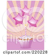 Star Decorations And A Birthday Candle On A Cupcake In A Pink Wrapper