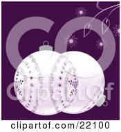 Two White Christmas Bauble Ornaments With Purple Snowflake Designs Over A Purple Background With Flowers And Leaves by elaineitalia