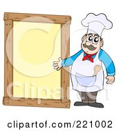 Male Chef Standing And Presenting A Blank Yellow Framed Sign