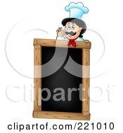 Male Chef Gesturing Ok Over A Blank Menu Chalk Board