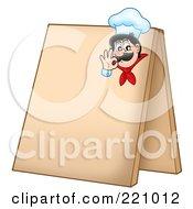 Male Chef Gesturing Ok On A Blank Sidewalk Board