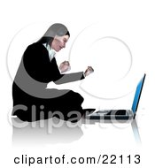 Professional Young Caucasian Businesswoman Sitting On The Floor In Front Of Her Laptop Computer Waving Her Fists And Smiling