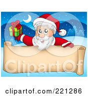 Royalty Free RF Clipart Illustration Of Santa Holding A Gift Over A Blank Parchment Scroll Banner Against A Winter Landscape