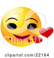 Yellow Female Emoticon Face With Big Black Eyes, A Mole And Pink Lips, Smiling With Red Hearts
