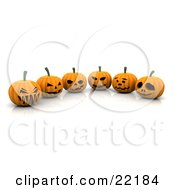 Six Orange Halloween Pumpkins Carved With Scary Jack O Lantern Faces Lined Up