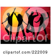 Silhouetted People Dancing Against A Red And Orange Burst Background