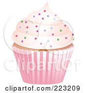 Royalty Free RF Clipart Illustration Of A Sprinkled Cupcake In A Pink Wrapper by elaineitalia