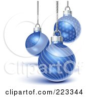 Three Blue Snowflake Line And Dot Patterned Christmas Ornaments Suspended From Silver Chains