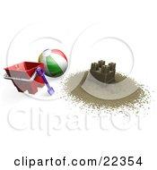 Sand Castle On The Beach With A Beach Ball Bucket And Shovel