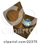 Planet Earth Inside A Wooden Treasure Chest