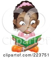 Happy African American Girl Reading A Book And Sitting On The Floor