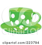 Royalty Free RF Clipart Illustration Of A Green Polka Dot Tea Or Coffee Cup On A Saucer by Pushkin