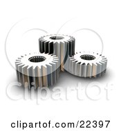 Clipart Illustration Of Three Different Sized Chrome Gears Spinning Together by KJ Pargeter
