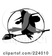 Royalty Free RF Clipart Illustration Of A Silhouetted Witch Flying Fast In Front Of A Full Moon