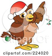 Brown Owl Wearing A Santa Hat And Christmas Bauble Holding Mistletoe
