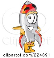 Royalty Free RF Clipart Illustration Of A Rocket Mascot Cartoon Character Leaning by Toons4Biz