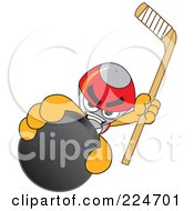 Royalty Free RF Clipart Illustration Of A Rocket Mascot Cartoon Character Grabbing A Hockey Puck by Toons4Biz