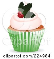 Royalty Free RF Clipart Illustration Of A Christmas Cupake With A Holly Garnish by elaineitalia